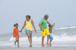 Family walking at the beach