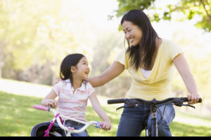 Mother and daughter riding bikes